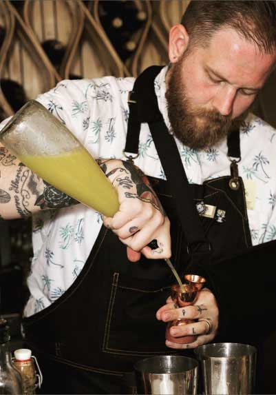 Chad Austin mixing a cocktail