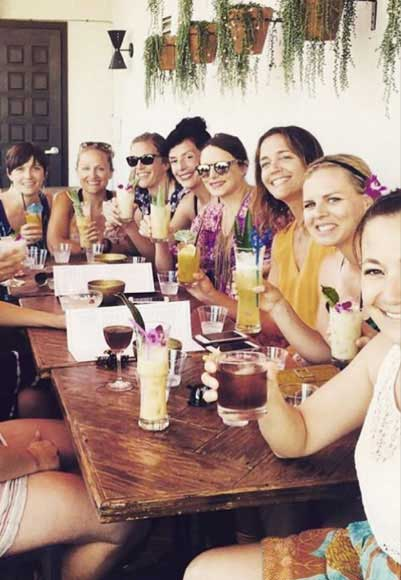 Group of ladies enjoying their tiki drinks.
